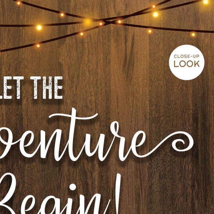 Close-up of Let the Adventure Begin Sign