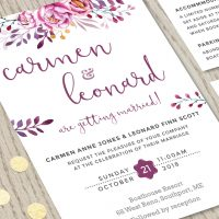Close-up of Wine Wedding Invitation Set